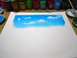 乾かないうちに雲を描きます。