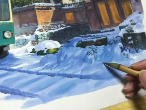 後から色を重ねて雪の部分を整えます。下の絵の具を剥がない様に気をつけます。